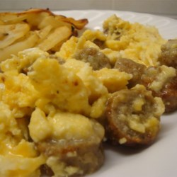 Sausage, Egg, and Cheese Scramble Recipe - This is a tasty scramble of scrambled eggs, cheese, and pieces of sausage. Great for a Sunday morning family breakfast! You may use as much of whatever type of cheese you prefer for this recipe.