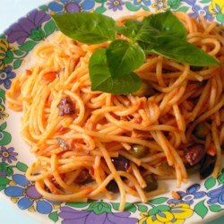 Puttanesca II Recipe - A good friend gave me this recipe and I've since found it to be so tasty and best of all, easy!  My family loves it and it doesn't take long to make at all!  Its perfect over angel hair pasta with garlic bread on the side! Double the recipe for larger parties or just for leftovers!