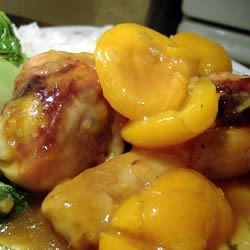 Apricot Chicken III Recipe - Chicken thighs are baked in dry onion soup mix and apricot nectar, with apricot halves.