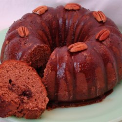 Bertha's Big Bourbon Bundt Cake Recipe - A ribbon of cocoa-pecan streusel fills this rich chocolate cake, which is made with butter and cream cheese and topped with an easy chocolate glaze.