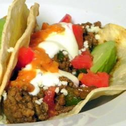 Tacos De Matamoros Recipe - A staple dish in Matamoros, Mexico, this simple recipe starts with ground beef mixed with spices that you already have in your kitchen and turns into a great family dinner! Perfect to 'make ahead' on busy days. Serve with warm corn or flour tortillas, Spanish rice, and beans-a-la-charra.
