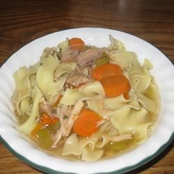 Old Man's Turkey Noodle Soup Recipe - A simple, delicious turkey noodle soup made with drumsticks cooks for a long time for maximum flavor. The noodles are cooked separately and added to the bowls at the end.