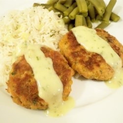 Salmon Cakes II Recipe - Cheddar cheese and parsley add to the color and taste of these flavorful patties. My neighbor tried them and has been passing around the recipe ever since!