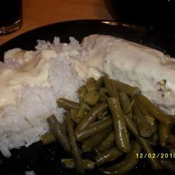 Chicken Bake and Rice Recipe - Herbed chicken is paired with a smooth cream cheese-wine sauce and served with rice.