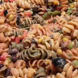 Mexican Fiesta Pasta Salad Recipe - This pasta salad recipe uses salsa, sour cream, black beans, and bell pepper to give a Mexican flair to an old favorite.