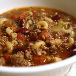 Pasta e Fagioli a la Chez Ivano Recipe - Ground beef, beef broth, lots of garlic, tomatoes, ditalini pasta and kidney beans are seasoned with thyme, basil, oregano and parsley in this traditional soup.