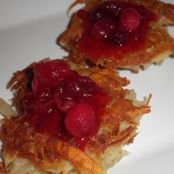 Foolproof Potato Latkes Recipe - Use a food processor to combine ingredients for these crisp potato latkes.