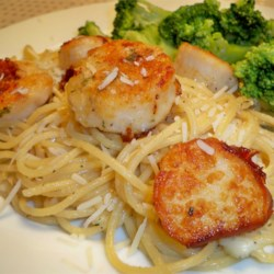 Seared Sea Scallops Recipe - These tender seared scallops with a delicate herb crust make an elegant main course.