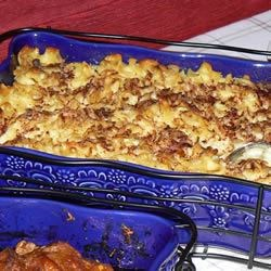 Applesauce Noodle Kugel Recipe - Tender noodles are stirred with a comforting blend of margarine, sour cream, egg substitute, sugar, lemon juice, vanilla extract, chunky applesauce, and raisins. Bake over a light sprinkling of graham cracker crumbs and top with cinnamon for a sweet treat.