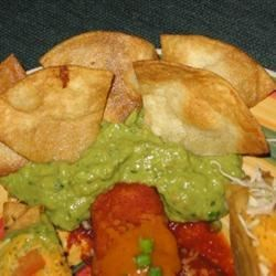 Guacamole and homemade corn chips.