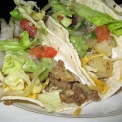 Central American Tacos Recipe - Wonderful authentic tacos I first tasted in Guatemala at a taco stand.  May be a little different to the American taste, but the green sauce is the crowning touch. The flavors are the subtle flavors of Central America.