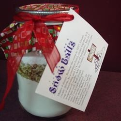 Snow Balls in a Jar Recipe - A favorite recipe at Christmas that can become someone's favorite gift. Share it with the ones you love.