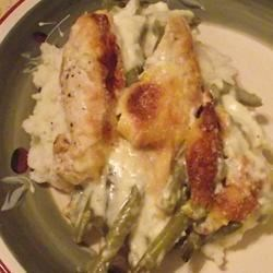 Chicken and Green Bean Casserole Recipe - This is a third generation recipe and one that is about as simple as it gets.  French-style green beans are topped with Chicken breasts, a creamy soup mixture, and a sprinkling of parmesan cheese and baked until bubbly. Best served over mashed potatoes or rice.