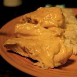 Easy Company Chicken Recipe -  Parmesan is the secret ingredient in this creamy curried chicken you whip up in a jiffy.