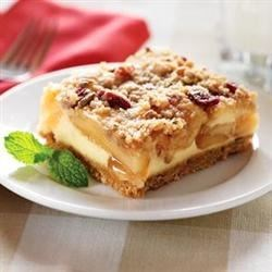 Harvest Apple Streusel Squares Recipe - These dessert bars are made with spiced apples in a creamy custard layer, and topped with a cranberry and pecan streusel.