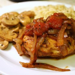 Braised Balsamic Chicken Recipe - Rich, slightly sweet balsamic vinegar intensifies the flavors of tomato and herbs in this chicken saute.