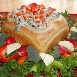 Hot Spinach Red Pepper Dip Recipe - A cheesy and creamy hot dip best served in a bread bowl or spread on toasted bread.