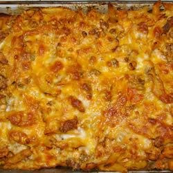Chicken and Chorizo Pasta Bake Recipe - Not a recipe for people on a diet - chicken, sausage, and penne is baked in a creamy tomato sauce.  I cook the meats, pasta, and sauce all at the same time, but it can be done individually and refrigerated before baking it in the oven.