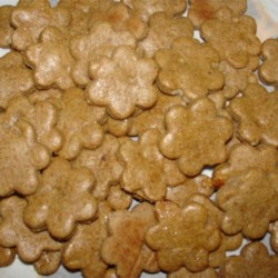 Peanut Butter and Banana Dog Biscuits Recipe - Crisp and crunchy, these easy-to-make, rolled, cut-out dog cookies combine peanut butter, honey, and an egg with whole wheat flour and wheat germ.