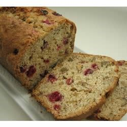 Cranberry Nut Bread II Recipe - This is a fast, festive bread for the Thanksgiving or Christmas holiday dinner table. Tart, fragrant and filled with nuts!