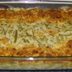 Green Bean Casserole III Recipe - Canned green beans are mixed with cream of mushroom soup and milk, and baked topped with crispy French fried onions in this classic American side dish.