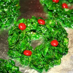 Christmas Wreaths Recipe - These Christmas wreaths are made using corn flakes and cinnamon candies. They're fun to make and eat.
