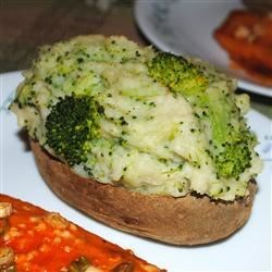 Parmesan and Broccoli Stuffed Potatoes Recipe - Potatoes are cooked in the microwave, then the flesh is combined with broccoli and parmesan cheese sauce.  The skins are filled with the creamy mixture, topped with cheese if desired, then baked again.