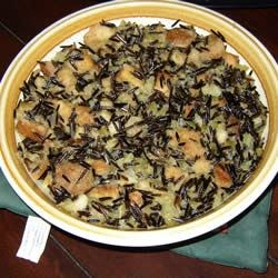 Wild Rice Stuffing for Turkey Recipe - Wild rice and croutons come together in this family-tested recipe that's been pleasing Thanksgiving crowds for years.