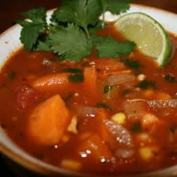 Spicy Chicken and Sweet Potato Stew Recipe - With flavors reminiscent of Morocco and Mexico, this easy yet richly-flavored stew contains loads of chicken, vegetables, and some surprising spices! If desired, pass lime wedges to squeeze over individual servings.
