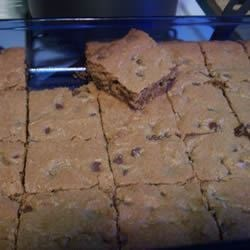 Chocolate Chip Cookie Bars Recipe - Is it a bar, or is it a cookie? Don't worry about it. Just eat these delicious treats packed with pecans and chocolate chips.