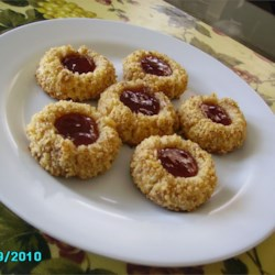 Thumbprint Cookies I Recipe - Thumbprint cookies are a Christmas tradition. Use your favorite jam to fill them, or use different flavors for a variety.