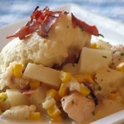 Bacon Chicken and Dumplings Recipe - Chicken, potatoes, onion, chicken broth, cream and seasonings all simmered in bacon drippings with dumpling dough and crumbled bacon.