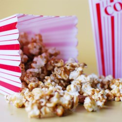 Caramel Popcorn Recipe and Video - Popcorn is coated with brown sugar and corn syrup caramel then baked for a crunchy treat.