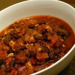 Meatiest Vegetarian Chili From Your Slow Cooker Recipe - This is one of the best, easiest, and tastiest vegetarian chili recipes I've ever tasted. Whenever I make it, my friends devour it. Best eaten with tortilla chips, Cheddar cheese, guacamole, and sour cream. What a treat!