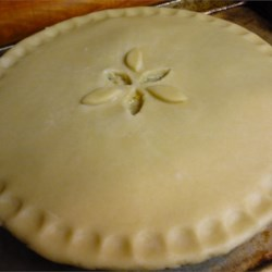 No Fail Pie Crust II Recipe - Lard, baking powder, and vinegar combine with flour, water, and an egg to create the perfect dough for a tender, flaky pie crust. This easy recipe makes four roll-out-like-a-dream crusts.
