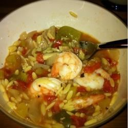 Shrimp Jambalaya Recipe - A flavorful blend of spices, vegetables, and chicken is cooked in the slow cooker. Orzo pasta and shrimp are stirred in at the end of the cooking time to round out this wonderful dish.