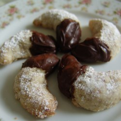 Viennese Crescent Holiday Cookies Recipe - These cookies have been a Christmas family favorite for 20 years. Flaky and buttery, they are worth the effort. Almonds can be substituted for hazelnuts.