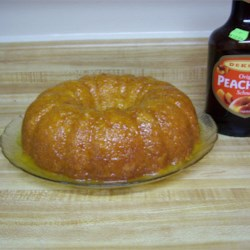 Fuzzy Navel Cake II Recipe - Peach schnapps and orange juice make this cake-mix-cake as fruity and delicious as the popular cocktail.