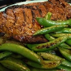 Whiskey-Marinated Steak Recipe - In this recipe, ribeye steaks sit overnight in a whiskey-based marinade with onions and garlic, before being grilled to your desired doneness.