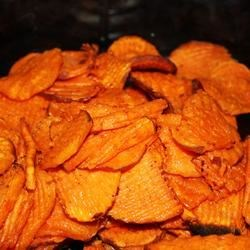 Spicy Sweet Potato Chips Recipe - A sweet and spicy snack made with cayenne pepper, maple syrup, olive oil, and sliced sweet potatoes.