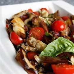Eggplant Tomato Salad Recipe - This incredible concoction of roasted peppers, eggplant and tomatoes is simmered with cayenne and tomato paste. It can be spooned onto a crisp bowl of greens, tossed into hot pasta, or spread on toasted rounds of French bread.