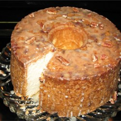 Pecan Sour Cream Pound Cake Recipe - A rich and delicious sour cream pound cake is baked in a Bundt pan lined with chopped pecans.