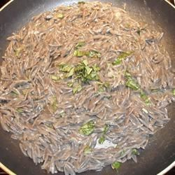 Black orzo with parmesan and basil