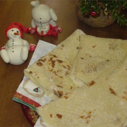 Christmas Lefse Recipe - This is a Norwegian-style lefse, that our family makes together every Christmas Eve morning.  The potato dough is refrigerated overnight to make the lefse more tender.  Delicious spread with butter and either white sugar or brown sugar!