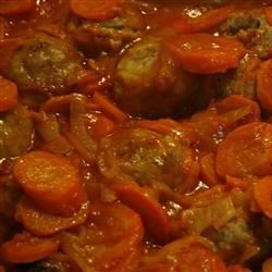 Applesauce Meatballs Recipe - Meatballs seasoned with applesauce and baked with tomato juice, onions, and carrots. Mom's family favorite!