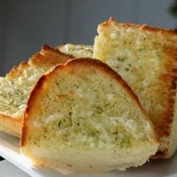 Great Garlic Bread Recipe - Italian bread is drenched in a butter and herb mixture, then loaded up with mozzarella cheese!
