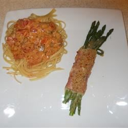 "Asparagus Rolantina Recipe - ""Tender asparagus spears are rolled in prosciutto and cheese, and topped with a crunchy breadcrumb and grated cheese crust. I recommend using pencil-thin asparagus."""