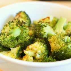 Roasted Garlic Lemon Broccoli Recipe and Video - Broccoli florets are roasted after being tossed in olive oil and sprinkled with sea salt, freshly ground black pepper, and minced garlic. A squeeze of lemon juice before serving seals the deal.