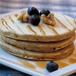 Whole Grain Pancakes Recipe - A combination of whole wheat flour, oats, cornmeal, and flaxseed flour give these pancakes lots of flavor.