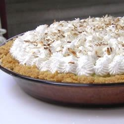Coconut Cream Pie II Recipe - A delicious chiffon pie made with freshly grated coconut and a vanilla wafer crust.